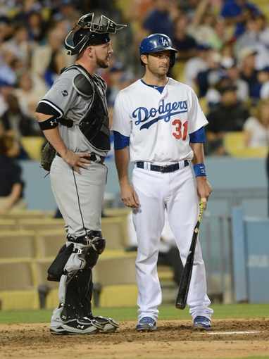 Jun 4, 2014; Los Angeles, CA, USA; Los Angeles Dodgers catcher Drew Butera (31) and Chicago White Sox catcher Tyler Flowers (21) talk at the plate during a review of a play in the fourth inning of the game at Dodger Stadium. Mandatory Credit: Jayne Kamin-Oncea-USA TODAY Sports