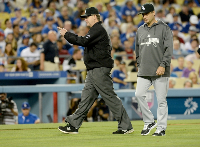 Jun 4, 2014; Los Angeles, CA, USA; Chicago White Sox manager Robin Ventura (23) calls for a review of a play by umpire Gary Cederstrom (38) in the fourth inning of the game against the Los Angeles Dodgers at Dodger Stadium. The call was overturned after a review of the play.  Mandatory Credit: Jayne Kamin-Oncea-USA TODAY Sports