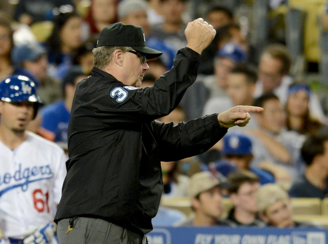 Jun 4, 2014; Los Angeles, CA, USA; MLB umpire Gary Cederstrom (38) signals as a review of a play is overturned in the the fourth inning of the game between the Los Angeles Dodgers and the Chicago White Sox at Dodger Stadium. Mandatory Credit: Jayne Kamin-Oncea-USA TODAY Sports
