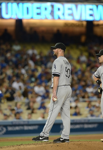 Jun 4, 2014; Los Angeles, CA, USA; Chicago White Sox starting pitcher John Danks (50) waits on the pitchers mound during a review of a play in the fourth inning of the game against the Los Angeles Dodgers at Dodger Stadium. Mandatory Credit: Jayne Kamin-Oncea-USA TODAY Sports