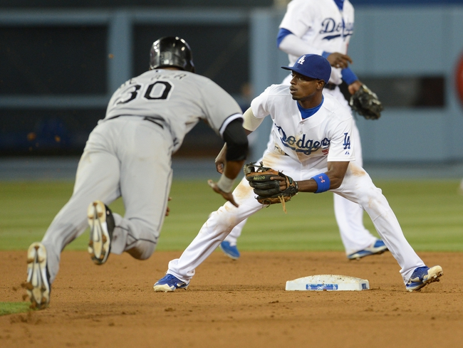 Jun 4, 2014; Los Angeles, CA, USA; Los Angeles Dodgers second baseman Dee Gordon (9) takes the throw as Chicago White Sox left fielder Alejandro De Aza (30) is out on a steal in the sixth inning of the game at Dodger Stadium. Mandatory Credit: Jayne Kamin-Oncea-USA TODAY Sports