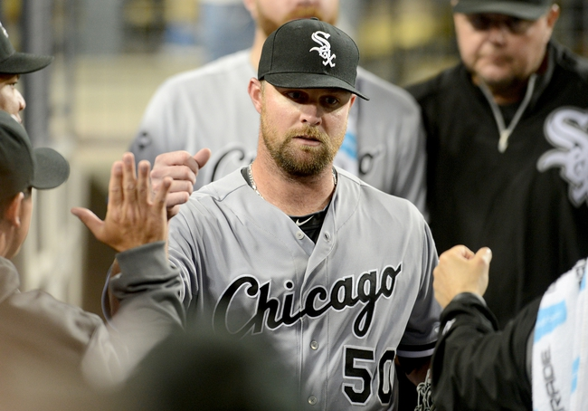 Jun 4, 2014; Los Angeles, CA, USA; Chicago White Sox starting pitcher John Danks (50) is greeted in the dugout after leaving the game in the eighth inning of the game against the Los Angeles Dodgers at Dodger Stadium. White Sox won 2-1. Mandatory Credit: Jayne Kamin-Oncea-USA TODAY Sports