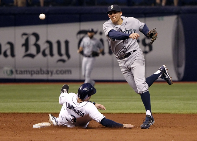 Jun 6, 2014; St. Petersburg, FL, USA; Seattle Mariners shortstop Brad Miller (5) forces out Tampa Bay Rays third baseman Evan Longoria (3) and attempted to throw the ball to first for a double play during the sixth inning at Tropicana Field. Mandatory Credit: Kim Klement-USA TODAY Sports