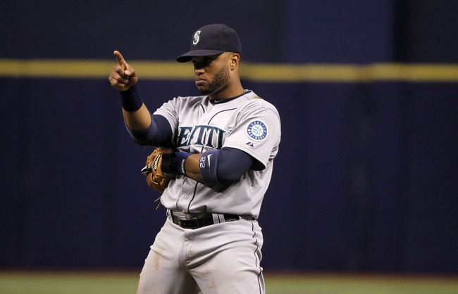 Jun 6, 2014; St. Petersburg, FL, USA; Seattle Mariners second baseman Robinson Cano (22) points against the Tampa Bay Rays at Tropicana Field. Tampa Bay Rays defeated the Seattle Mariners 4-0. Mandatory Credit: Kim Klement-USA TODAY Sports