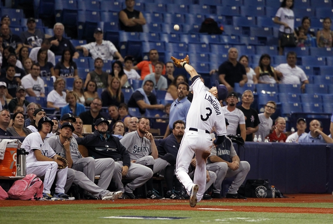 Jun 6, 2014; St. Petersburg, FL, USA; Tampa Bay Rays third baseman Evan Longoria (3) catches a fly ball during the eighth inning against the Seattle Mariners at Tropicana Field. Tampa Bay Rays defeated the Seattle Mariners 4-0. Mandatory Credit: Kim Klement-USA TODAY Sports
