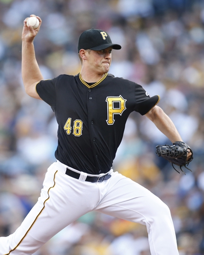 Jun 7, 2014; Pittsburgh, PA, USA; Pittsburgh Pirates relief pitcher Jared Hughes (48) pitches against the Milwaukee Brewers during the seventh inning at PNC Park. The Brewers won 9-3. Mandatory Credit: Charles LeClaire-USA TODAY Sports
