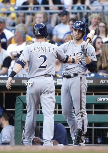 Jun 7, 2014; Pittsburgh, PA, USA; Milwaukee Brewers second baseman Scooter Gennett (2) is greeted by right fielder Ryan Braun (8) after Gennett scored against the Pittsburgh Pirates during the eighth inning at PNC Park. The Brewers won 9-3. Mandatory Credit: Charles LeClaire-USA TODAY Sports