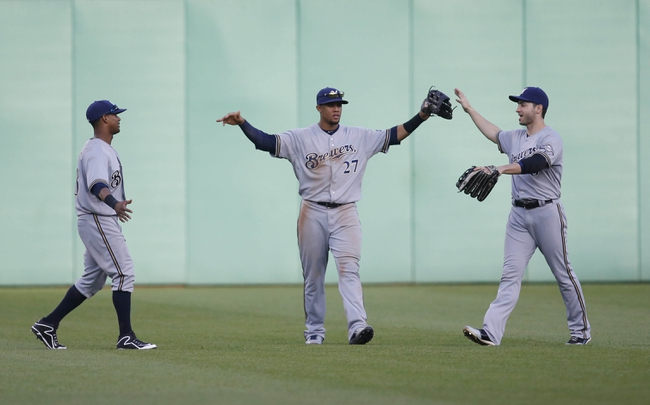 Jun 7, 2014; Pittsburgh, PA, USA; Milwaukee Brewers out fielders Khris Davis (left) and Carlos Gomez (middle) and Ryan Braun (right) celebrate in the outfield after defeating the Pittsburgh Pirates at PNC Park. The Brewers won 9-3. Mandatory Credit: Charles LeClaire-USA TODAY Sports