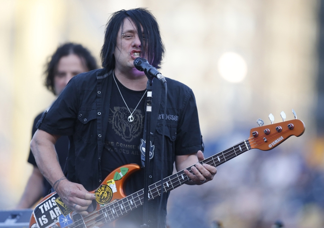 Jun 7, 2014; Pittsburgh, PA, USA;  Performing artist Robby Takac of the band Goo Goo Dolls performs during a post-game concert after the Milwaukee Brewers defeated the Pittsburgh Pirates at PNC Park. The Brewers won 9-3. Mandatory Credit: Charles LeClaire-USA TODAY Sports