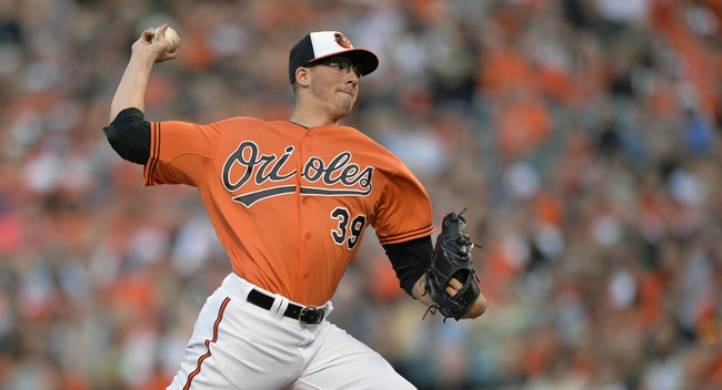Jun 7, 2014; Baltimore, MD, USA; Baltimore Orioles starting pitcher Kevin Gausman (39) throws in the second inning against the Oakland Athletics at Oriole Park at Camden Yards. Mandatory Credit: Joy R. Absalon-USA TODAY Sports