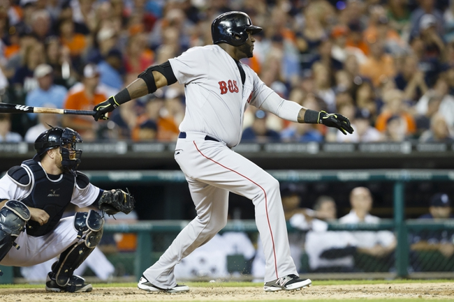 Jun 7, 2014; Detroit, MI, USA; Boston Red Sox designated hitter David Ortiz (34) hits an RBI double in the seventh inning against the Detroit Tigers at Comerica Park. Mandatory Credit: Rick Osentoski-USA TODAY Sports