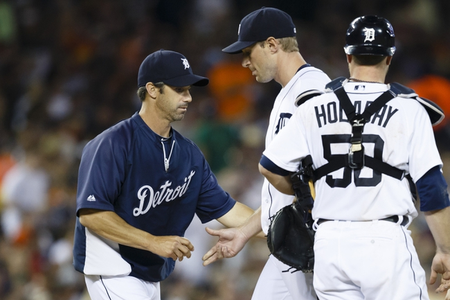 Jun 7, 2014; Detroit, MI, USA; Detroit Tigers manager Brad Ausmus (left) takes the ball to relieve starting pitcher Max Scherzer (37) in the seventh inning against the Boston Red Sox at Comerica Park. Mandatory Credit: Rick Osentoski-USA TODAY Sports