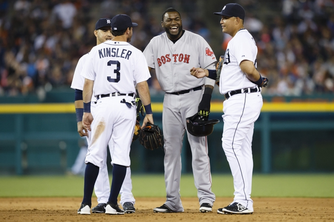 Jun 7, 2014; Detroit, MI, USA; Boston Red Sox designated hitter David Ortiz (34) talks to Detroit Tigers second baseman Ian Kinsler (3) shortstop Eugenio Suarez (left) and first baseman Miguel Cabrera (right) during a pitching change in the seventh inning at Comerica Park. Mandatory Credit: Rick Osentoski-USA TODAY Sports