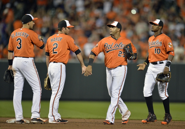 Jun 7, 2014; Baltimore, MD, USA; Baltimore Orioles teammates celebrate after a game against the Oakland Athletics at Oriole Park at Camden Yards. The Orioles defeated the Athletics 6-3. Mandatory Credit: Joy R. Absalon-USA TODAY Sports