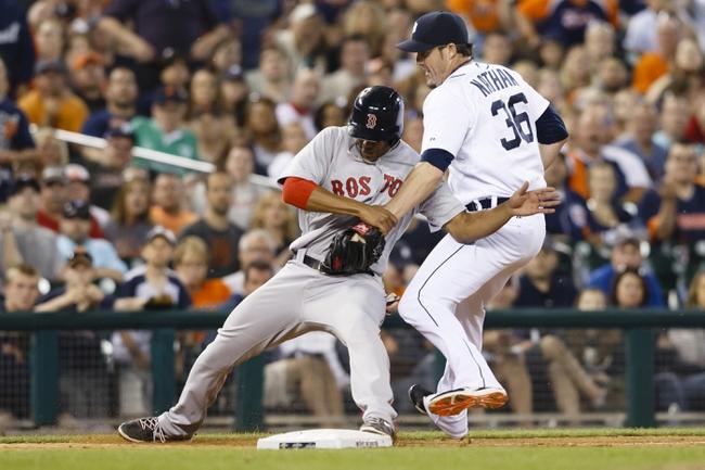 Jun 7, 2014; Detroit, MI, USA; Detroit Tigers relief pitcher Joe Nathan (36) tries to tag Boston Red Sox third baseman Xander Bogaerts (2) as he steals third base in the ninth inning at Comerica Park. Detroit won 8-6. Mandatory Credit: Rick Osentoski-USA TODAY Sports