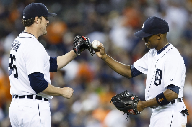 Jun 7, 2014; Detroit, MI, USA; Detroit Tigers relief pitcher Joe Nathan (left) and center fielder Austin Jackson (right) celebrate after the game against the Boston Red Sox at Comerica Park. Detroit won 8-6. Mandatory Credit: Rick Osentoski-USA TODAY Sports