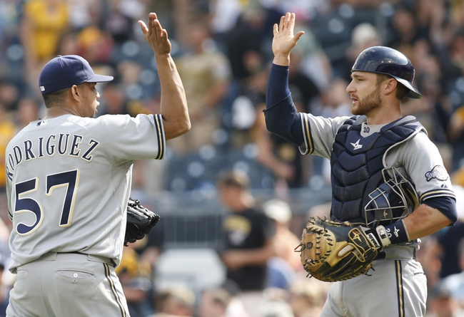 Jun 8, 2014; Pittsburgh, PA, USA; Milwaukee Brewers relief pitcher Francisco Rodriguez (57) celebrates with catcher Jonathan Lucroy (R) after defeating the Pittsburgh Pirates 1-0 at PNC Park. Mandatory Credit: Charles LeClaire-USA TODAY Sports