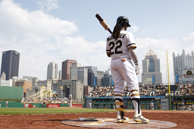 Jun 8, 2014; Pittsburgh, PA, USA; Pittsburgh Pirates center fielder Andrew McCutchen (22) in the on-deck circle against the Milwaukee Brewers during the eighth inning at PNC Park. The Brewers won 1-0. Mandatory Credit: Charles LeClaire-USA TODAY Sports