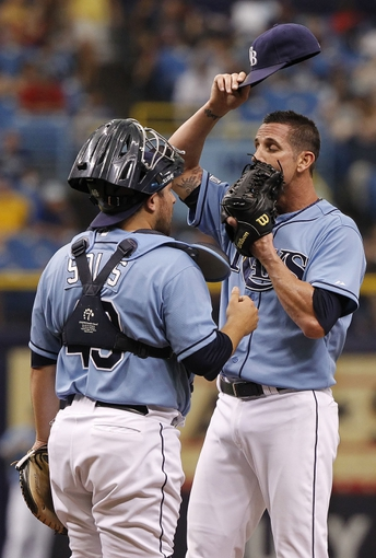 Jun 8, 2014; St. Petersburg, FL, USA; Tampa Bay Rays relief pitcher Grant Balfour (50) talks with catcher Ali Solis (43) on the mound during the ninth inning against the Seattle Mariners at Tropicana Field. The Mariners won 5-0. Mandatory Credit: Kim Klement-USA TODAY Sports