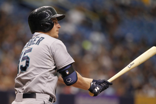 Jun 8, 2014; St. Petersburg, FL, USA; Seattle Mariners third baseman Kyle Seager (15) hits a 2 RBI triple during the ninth inning against the Tampa Bay Rays at Tropicana Field. The Mariners won 5-0. Mandatory Credit: Kim Klement-USA TODAY Sports