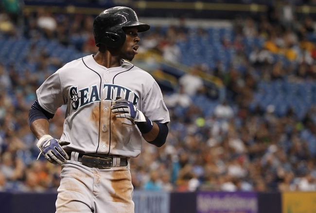 Jun 8, 2014; St. Petersburg, FL, USA; Seattle Mariners center fielder James Jones (99) scored during the ninth inning against the Tampa Bay Rays at Tropicana Field. The Mariners won 5-0. Mandatory Credit: Kim Klement-USA TODAY Sports