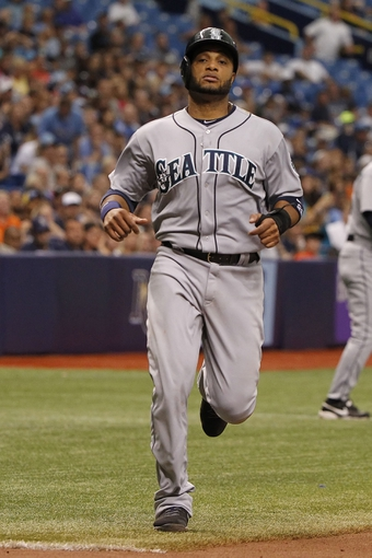 Jun 8, 2014; St. Petersburg, FL, USA; Seattle Mariners second baseman Robinson Cano (22) scores during the ninth inning against the Tampa Bay Rays at Tropicana Field. The Mariners won 5-0. Mandatory Credit: Kim Klement-USA TODAY Sports