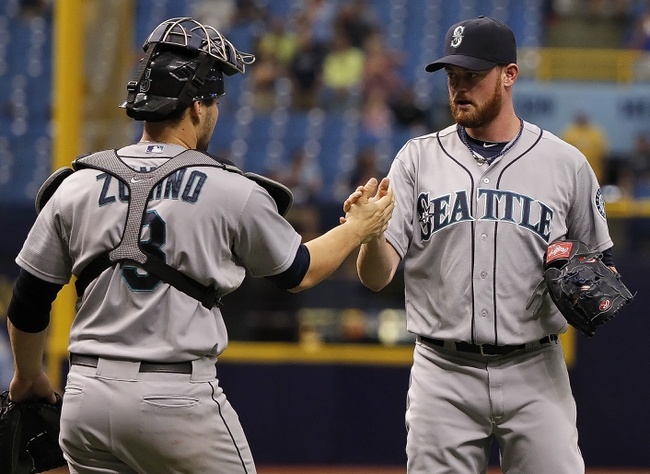 Jun 8, 2014; St. Petersburg, FL, USA; Seattle Mariners relief pitcher Charlie Furbush (41) celebrates with catcher Mike Zunino (3) after defeating the Tampa Bay Rays 5-0 at Tropicana Field. Mandatory Credit: Kim Klement-USA TODAY Sports