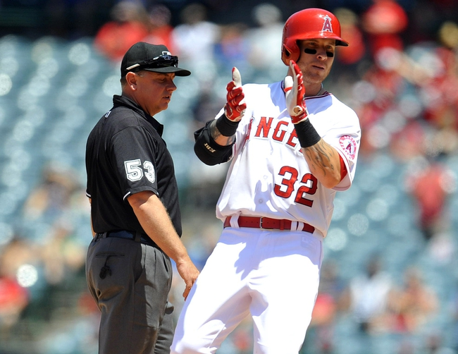 June 8, 2014; Anaheim, CA, USA; Los Angeles Angels left fielder Josh Hamilton (32) reacts after reaching second on a two run RBI double in the fifth inning against the Chicago White Sox at Angel Stadium of Anaheim. Mandatory Credit: Gary A. Vasquez-USA TODAY Sports