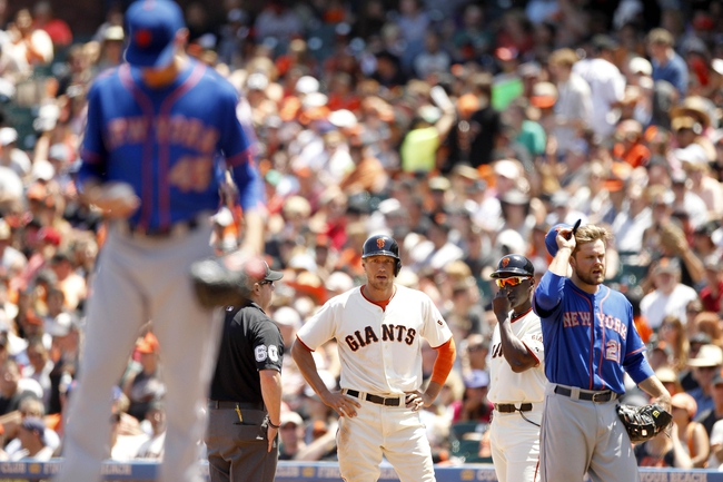 Jun 8, 2014; San Francisco, CA, USA; San Francisco Giants outfielder Hunter Pence (8) stands on first base after being hit by a pitch by New York Mets pitcher Zack Wheeler (45) in the third inning at AT&T Park. Mandatory Credit: Cary Edmondson-USA TODAY Sports
