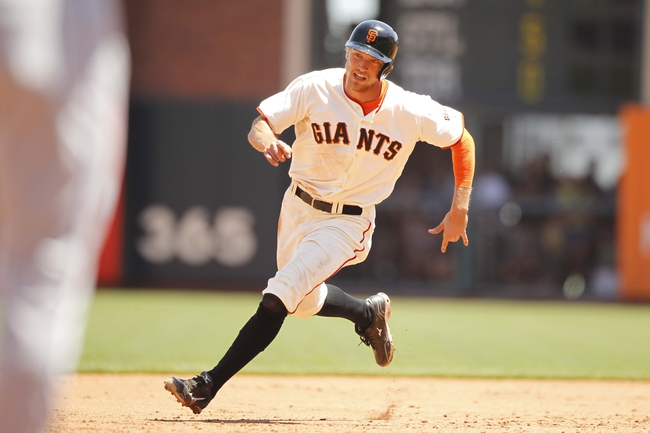 Jun 8, 2014; San Francisco, CA, USA; San Francisco Giants outfielder Hunter Pence (8) runs towards third base against the New York Mets in the third inning at AT&T Park. Mandatory Credit: Cary Edmondson-USA TODAY Sports