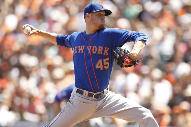 Jun 8, 2014; San Francisco, CA, USA; New York Mets pitcher Zack Wheeler (45) prepares to deliver a pitch against the San Francisco Giants in the third inning at AT&T Park. Mandatory Credit: Cary Edmondson-USA TODAY Sports