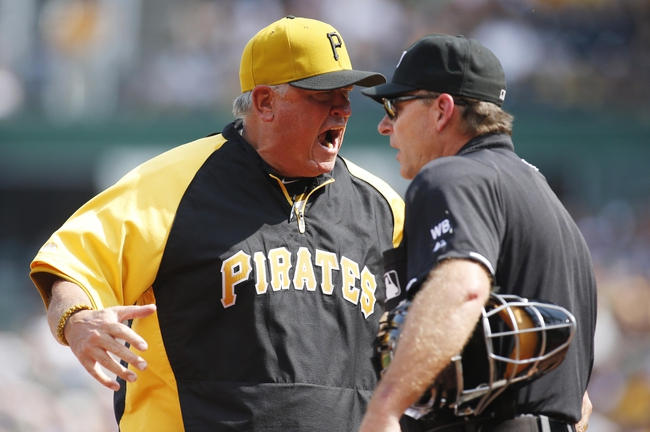 Jun 8, 2014; Pittsburgh, PA, USA; Pittsburgh Pirates manager Clint Hurdle (left) argues with home plate umpire Ed Hickox (right) after catcher Russell Martin (not pictured) was ejected against the Milwaukee Brewers during the eighth inning at PNC Park. The Brewers won 1-0. Mandatory Credit: Charles LeClaire-USA TODAY Sports