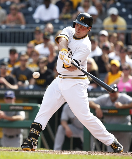 Jun 8, 2014; Pittsburgh, PA, USA; Pittsburgh Pirates pinch hitter Travis Snider (23) hits into a fielders choice against the Milwaukee Brewers during the ninth inning at PNC Park. The Brewers won 1-0. Mandatory Credit: Charles LeClaire-USA TODAY Sports
