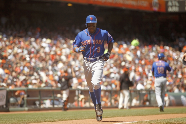 Jun 8, 2014; San Francisco, CA, USA; New York Mets outfielder Curtis Granderson (3) jogs towards home plate after hitting a home run against the San Francisco Giants in the sixth inning at AT&T Park. Mandatory Credit: Cary Edmondson-USA TODAY Sports