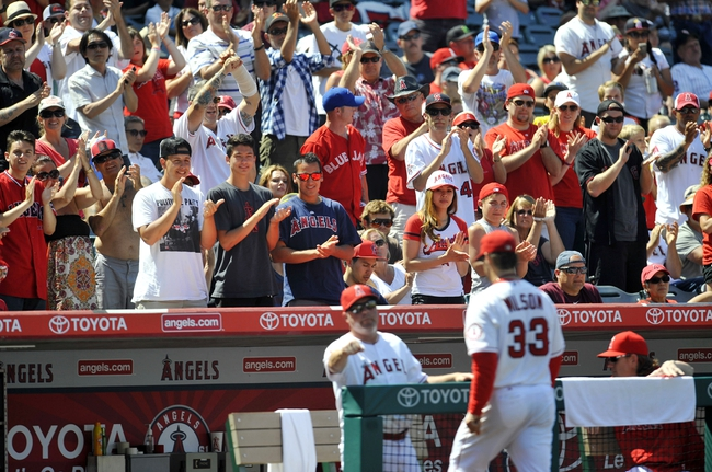 June 8, 2014; Anaheim, CA, USA; Fans cheer in the eighth inning as Los Angeles Angels starting pitcher C.J. Wilson (33)is relieved against the Chicago White Sox in the eighth inning at Angel Stadium of Anaheim. Mandatory Credit: Gary A. Vasquez-USA TODAY Sports