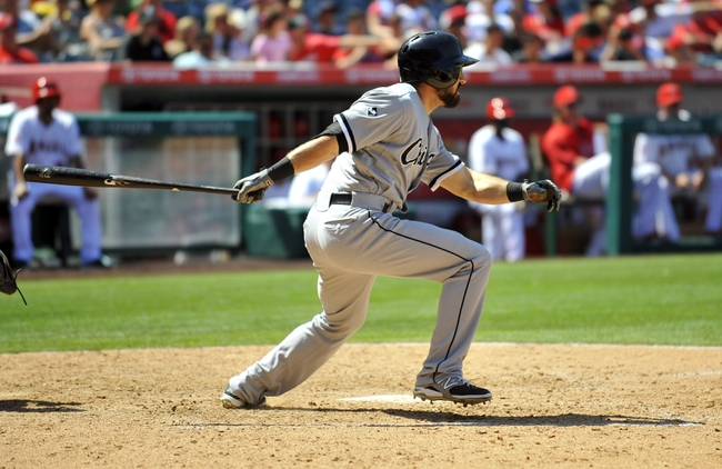 June 8, 2014; Anaheim, CA, USA; Chicago White Sox center fielder Adam Eaton (1) hits an RBI single in the eighth inning against the Los Angeles Angels at Angel Stadium of Anaheim. Mandatory Credit: Gary A. Vasquez-USA TODAY Sports
