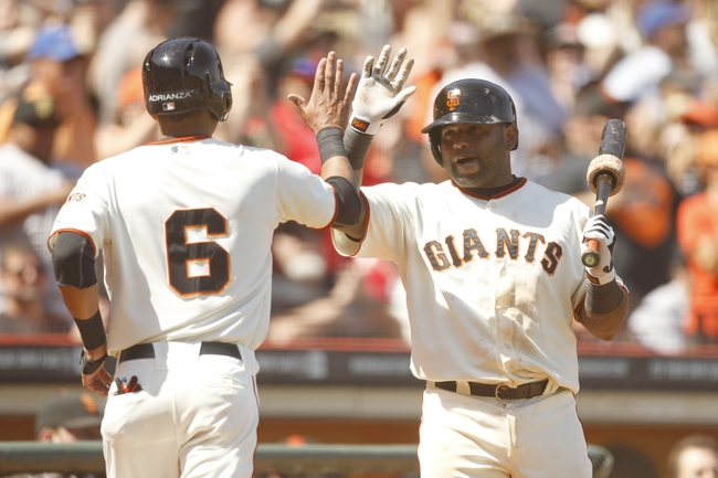 Jun 8, 2014; San Francisco, CA, USA; San Francisco Giants infielder Ehire Adrianza (6) is congratulated by infielder Pablo Sandoval (48) after scoring a run against the New York Mets in the seventh inning at AT&T Park. The Giants defeated the Mets 6-4. Mandatory Credit: Cary Edmondson-USA TODAY Sports