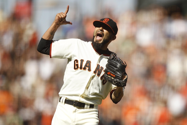 Jun 8, 2014; San Francisco, CA, USA; San Francisco Giants pitcher Sergio Romo (54) reacts after recording the final out of the ninth inning against the New York Mets at AT&T Park. The Giants defeated the Mets 6-4. Mandatory Credit: Cary Edmondson-USA TODAY Sports