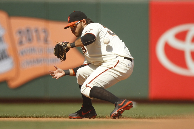 Jun 8, 2014; San Francisco, CA, USA; San Francisco Giants infielder Brandon Crawford (35) bobbles the ball before regaining control to make a throw to first to record an out against the New York Mets in the eighth inning at AT&T Park. The Giants defeated the Mets 6-4. Mandatory Credit: Cary Edmondson-USA TODAY Sports