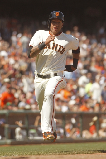 Jun 8, 2014; San Francisco, CA, USA; San Francisco Giants infielder Ehire Adrianza (6) scores a run against the New York Mets in the seventh inning at AT&T Park. The Giants defeated the Mets 6-4. Mandatory Credit: Cary Edmondson-USA TODAY Sports