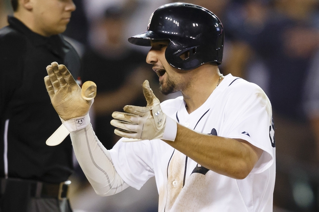 Jun 8, 2014; Detroit, MI, USA; Detroit Tigers third baseman Nick Castellanos (9) reacts after scoring in the seventh inning against the Boston Red Sox at Comerica Park. Mandatory Credit: Rick Osentoski-USA TODAY Sports