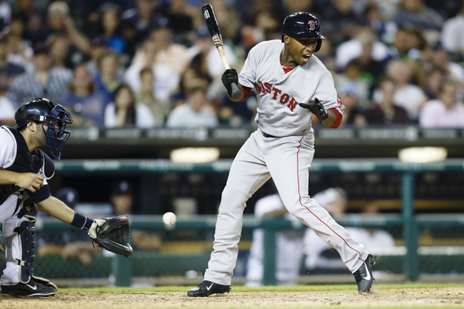 Jun 8, 2014; Detroit, MI, USA; Boston Red Sox short stop Jonathan Herrera (10) reacts as he is hit by the pitch in the eighth inning against the Detroit Tigers at Comerica Park. Mandatory Credit: Rick Osentoski-USA TODAY Sports