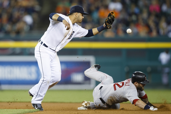 Jun 8, 2014; Detroit, MI, USA; Boston Red Sox first baseman Mike Napoli (12) steals second base as Detroit Tigers short atop Eugenio Suarez (30) loses the ball in the eighth inning at Comerica Park. Mandatory Credit: Rick Osentoski-USA TODAY Sports