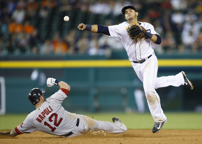 Jun 8, 2014; Detroit, MI, USA; Detroit Tigers shortstop Eugenio Suarez (30) makes a throw to first to complete a double play as Boston Red Sox first baseman Mike Napoli (12) slides into second in the ninth inning at Comerica Park. Boston won 5-3. Mandatory Credit: Rick Osentoski-USA TODAY Sports