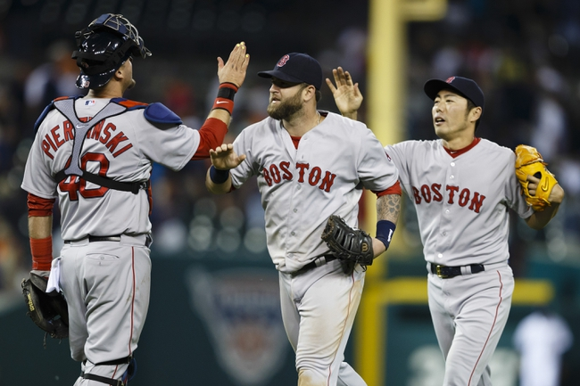 Jun 8, 2014; Detroit, MI, USA; Boston Red Sox catcher A.J. Pierzynski (40) and first baseman Mike Napoli (center) and relief pitcher Koji Uehara (right) celebrate after the game against the Detroit Tigers at Comerica Park. Boston won 5-3. Mandatory Credit: Rick Osentoski-USA TODAY Sports