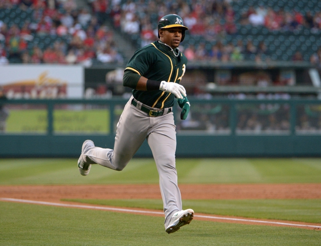 Jun 9, 2014; Anaheim, CA, USA; Oakland Athletics left fielder Yoenis Cespedes (52) rounds third base to score in the second inning against the Los Angeles Angels at Angel Stadium of Anaheim. Mandatory Credit: Kirby Lee-USA TODAY Sports