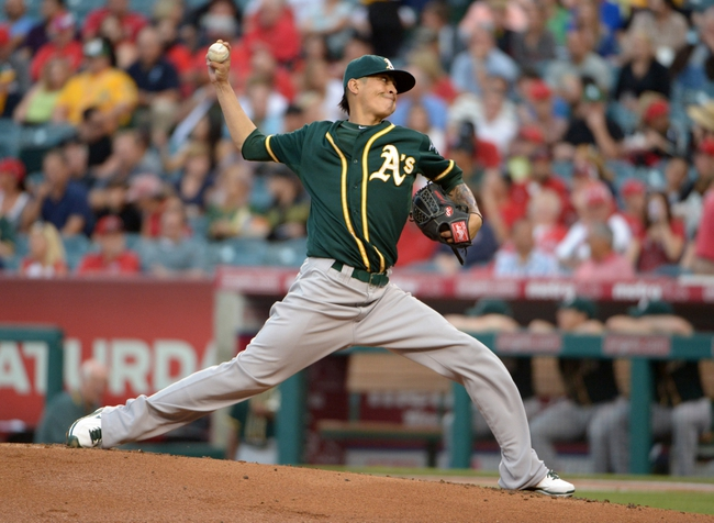 Jun 9, 2014; Anaheim, CA, USA; Oakland Athletics starter Jesse Chavez (60) delivers a pitch against the Los Angeles Angels at Angel Stadium of Anaheim. Mandatory Credit: Kirby Lee-USA TODAY Sports
