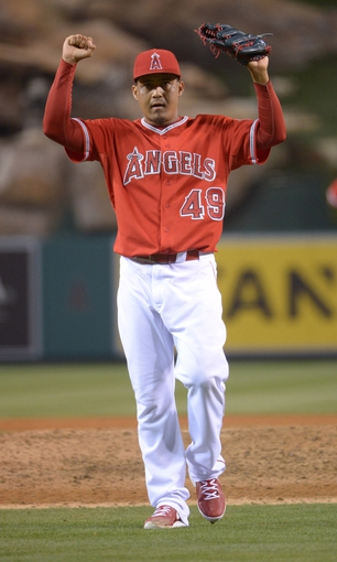 Jun 9, 2014; Anaheim, CA, USA; Los Angeles Angels reliever Ernesto Frieri (49) celebrates at the end of the game against the Oakland Athletics at Angel Stadium of Anaheim. The Angels defeated the Athletics 4-1. Mandatory Credit: Kirby Lee-USA TODAY Sports