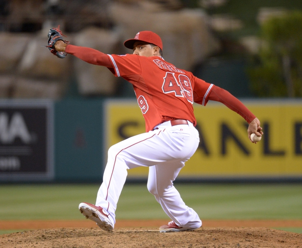 Jun 9, 2014; Anaheim, CA, USA; Los Angeles Angels reliever Ernesto Frieri (49) delivers a pitch in the ninth inning against the Oakland Athletics at Angel Stadium of Anaheim. The Angels defeated the Athletics 4-1. Mandatory Credit: Kirby Lee-USA TODAY Sports