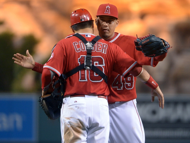 Jun 9, 2014; Anaheim, CA, USA; Los Angeles Angels reliever Ernesto Frieri (49) and catcher Hank Conger embrace after the game against the Oakland Athletics at Angel Stadium of Anaheim. The Angels defeated the Athletics 4-1. Mandatory Credit: Kirby Lee-USA TODAY Sports